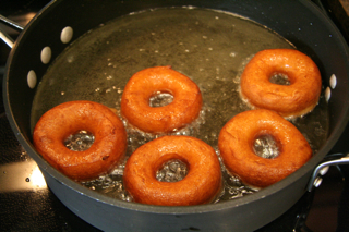 Donuts frying - ready to be taken out
